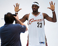 James poses for a photographer during the Cleveland Cavaliers media day yesterday at Quicken Loans Arena.