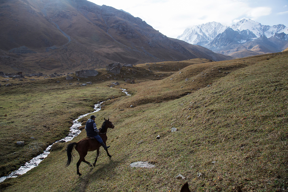 September 17 2016 Nurdin Orozaliev rides towards the glaciers that lie at the base of Chok Tal peak in the Chon Kemin Valley in northern Kyrgyzstan. Climate change in Kyrgyzstan is affecting cross border water rights in the already ethnically divided Fergana Valley, all while glaciers melt in the Tian Shan Mountains. Tensions are rising as different groups compete for scarcer and scarcer resources.