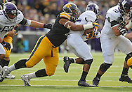 October 26 2013: Iowa Hawkeyes defensive lineman Carl Davis (71) hits Northwestern Wildcats running back Stephen Buckley (8) on a run during the first quarter of the NCAA football game between the Northwestern Wildcats and the Iowa Hawkeyes at Kinnick Stadium in Iowa City, Iowa on October 26, 2013.