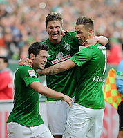 FUSSBALL   1. BUNDESLIGA   SAISON 2012/2013   4. SPIELTAG SV Werder Bremen - VfB Stuttgart                         23.09.2012        Zlatko Junuzovic, Sebastian Proedl und Marko Arnautovic (v.l., alle SV Werder Bremen)  jubeln nach dem 2:0