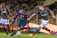 Portugal, FUNCHAL : Benfica's Argentine midfielder Salvio  (L )  vies with Maritimo's Brazilian midfielder Bruno Gallo   (R ) during Portuguese League football match Maritimo vs S.L. Benfica at Barreiros Stadium in Funchal on January  18, 2015. PHOTO/ GREGORIO CUNHA