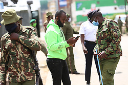 May 11, 2020, Nairobi, Kenya: Police officers screen residents in Eastleigh during the protest..Eastleigh Residents took to the street to protest restriction of movement in the area due to the widespread case of Covid-19 within the residential area and appealed to the government to provide them with relief food. Kenya has confirmed 672 cases of Covid-19 and 32 deaths. (Credit Image: © Billy Mutai/SOPA Images via ZUMA Wire)