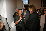 Miuccia Prada and Julia Peyton-Jones, EXHIBITION OF WORK BY THOMAS DEMAND ( SUPPORTED BY WALLPAPER) AT THE SERPENTINE GALLERY AND AFTERWARDS AT THE Rochelle Canteen, Rochelle School<br />Arnold Circus. London E2. 5 JUNE 2006. ONE TIME USE ONLY - DO NOT ARCHIVE  © Copyright Photograph by Dafydd Jones 66 Stockwell Park Rd. London SW9 0DA Tel 020 7733 0108 www.dafjones.com