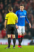 Kyle Lafferty (#11) of Rangers FC speaks with referee Steven McLean during the Ladbrokes Scottish Premiership match between Rangers and Aberdeen at Ibrox, Glasgow, Scotland on 5 December 2018.