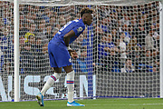Chelsea forward Tammy Abraham (9) clutches his hand in pain during the Champions League match between Chelsea and Valencia CF at Stamford Bridge, London, England on 17 September 2019.