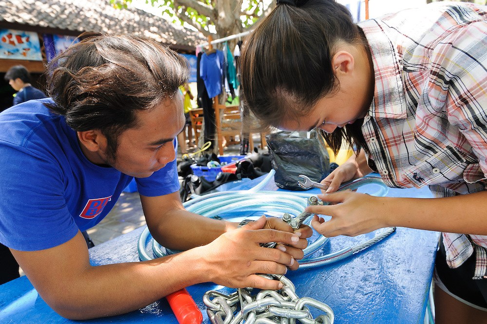 Komang Astari from the Kerang Lestari Foundation and a student from Kuala Lumpur International School preparing a cable that will be used to anchor a Resen Wave generator above a Biorock installation, Pemuteran, Bali, Indonesia.