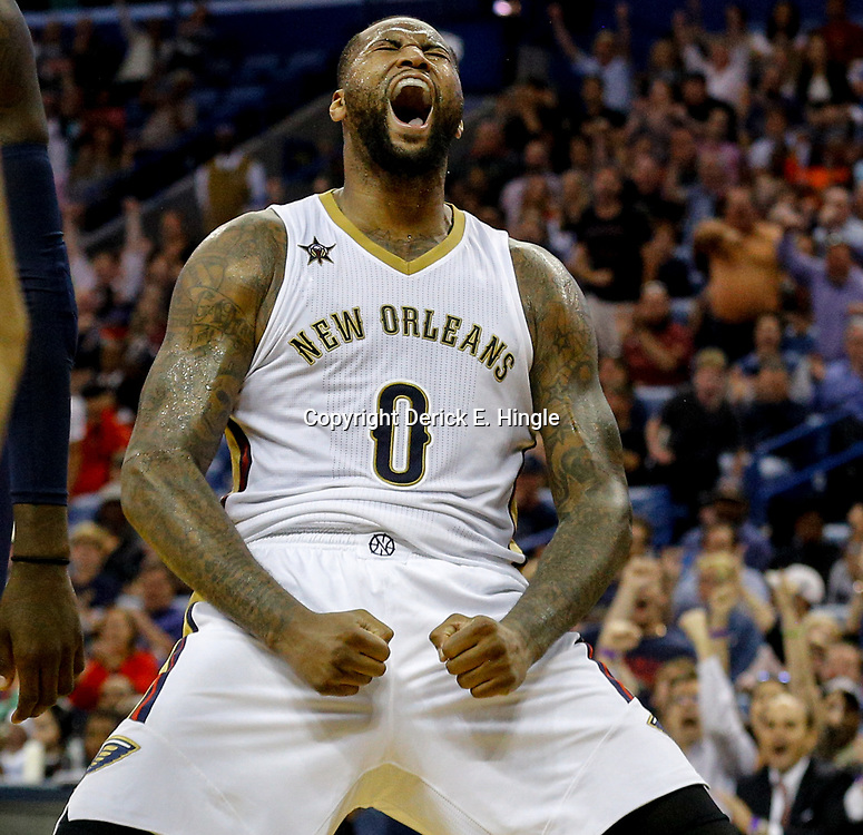 Mar 21, 2017; New Orleans, LA, USA; New Orleans Pelicans forward DeMarcus Cousins (0) celebrates after scoring and drawing a foul during the fourth quarter of a game against the Memphis Grizzlies at the Smoothie King Center. The Pelicans defeated the Grizzlies 95-82. Mandatory Credit: Derick E. Hingle-USA TODAY Sports