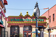 Orange Daily News Building Starbucks Coffee at Old Towne Orange Plaza