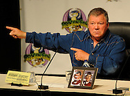 0909042 - Atlanta -  Former Star Trek star William Shatner, Captain James Tiberius Kirk, gestures  during his conversation with Leonard Nimoy, Mr.Spock,  during the Dragon Con convention at the Hyatt on Friday, September 4, 2009. ©2009 Johnny Crawford