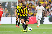 Watford forward Troy Deeney (9) passes the ball forward during the Premier League match between Watford and Manchester United at Vicarage Road, Watford, England on 15 September 2018.