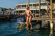 Tourist in Utila, Honduras, a small former fishing community that turned to dive tourism as a means of making money. Most of the income now comes from tourists coming to dive or learning how to dive.