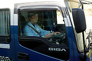 truck driver looking in his rearview mirror