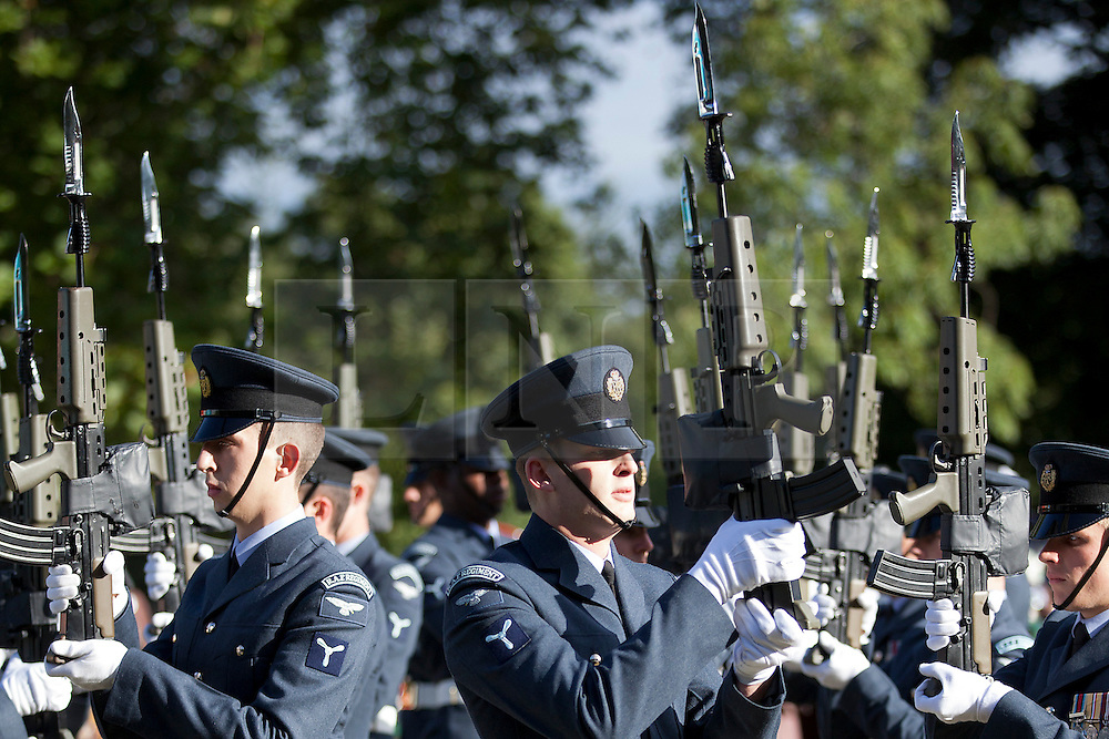 © Licensed to London News Pictures. 12/09/2012. LONDON, UK. Airmen of the Royal Air Force's ceremonial unit, the Queen's Colour Squadron carry out drill moves in Hyde Park London today (12/09/12) during a taster of some of the acts taking part in the 2012 British Military Tournament. The theme of this year's tournament, involving all arms of the British military, is the life and times of Her Majesty the Queen and takes place at Earls Court in London on the 8th and 9th of December. Photo credit: Matt Cetti-Roberts/LNP
