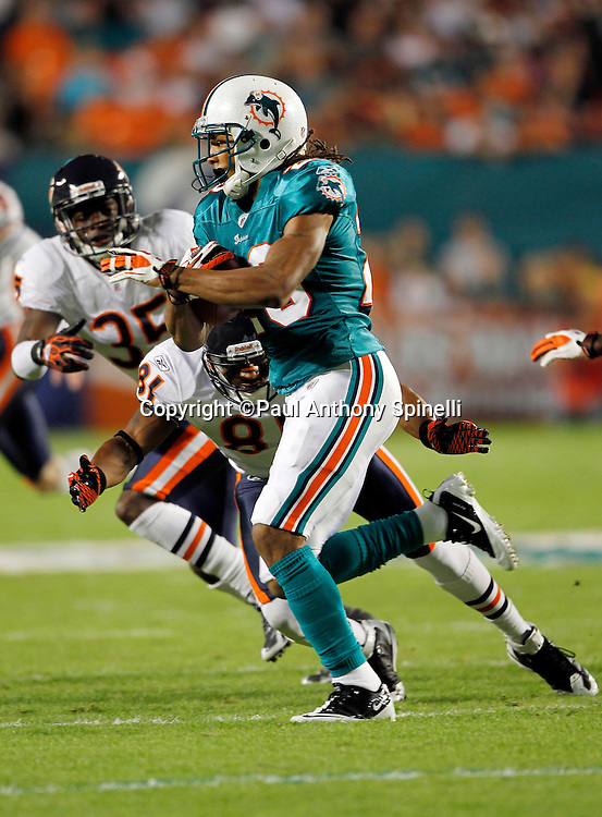 Miami Dolphins kick returner Nolan Carroll (28) returns a kickoff during the NFL week 11 football game against the Chicago Bears on Thursday, November 18, 2010 in Miami Gardens, Florida. The Bears won the game 16-0. (©Paul Anthony Spinelli)