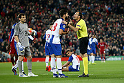 Referee Antonio Mateu Lahoz has some stern words for FC Porto defender Felipe (28) during the Champions League Quarter-Final Leg 1 of 2 match between Liverpool and FC Porto at Anfield, Liverpool, England on 9 April 2019.