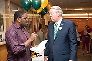 Ph.D. student Keith Phetlhe (Left) talks with President Nellis at the 50th Anniversary of Alden Library. Photo by Ben Siegel