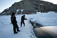 Sasa Samson 37 checks the rifle of Manik 16 in Resolute Bay. Tuesday June 12 2007.