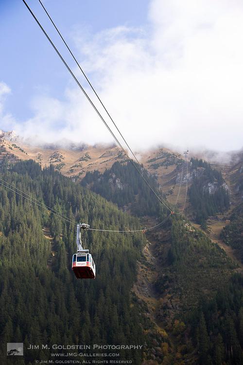 A cable car (gondola) travels down from Männlichen to Wengen, Switzerland