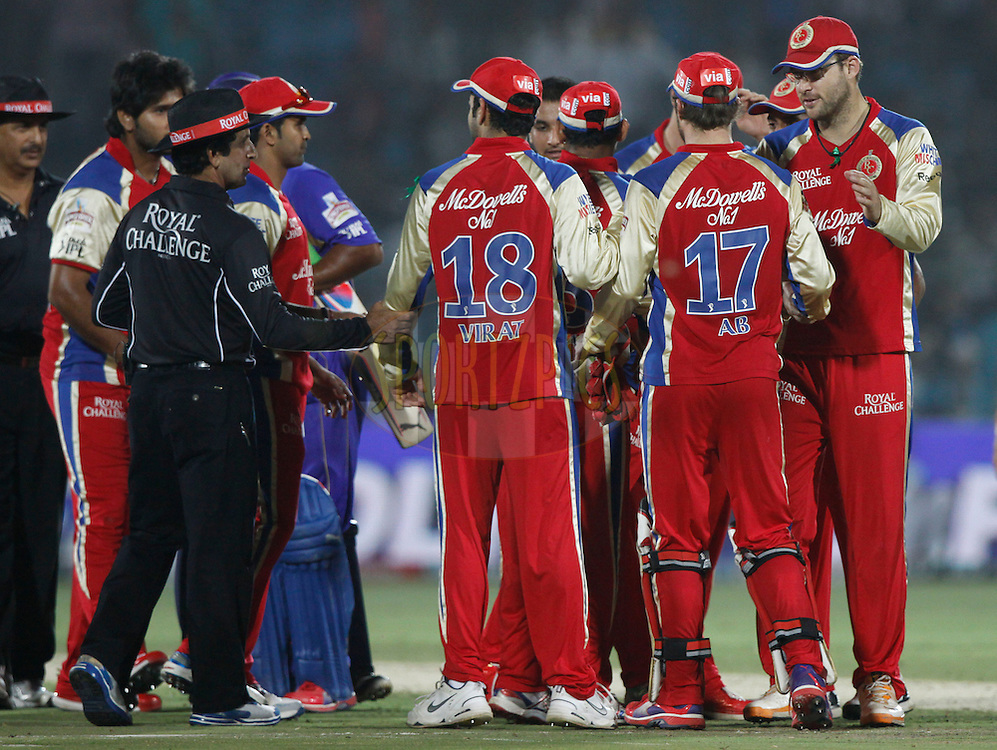 Royal Challengers Bangalore players celebrates their victory during match 30 of the the Indian Premier League ( IPL) 2012  between The Rajasthan Royals and the Royal Challengers Bangalore held at the Sawai Mansingh Stadium in Jaipur on the 23rd April 2012..Photo by Pankaj Nangia/IPL/SPORTZPICS