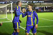James Ball scores a goal to make it 3-0 and celebrates with Jake Beesley during the The FA Cup match between Solihull Moors and Rotherham United at the Automated Technology Group Stadium, Solihull, United Kingdom on 2 December 2019.