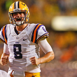 Sep 21, 2013; Baton Rouge, LA, USA; LSU Tigers quarterback Zach Mettenberger (8) celebrates after a touchdown by =LSU Tigers fullback J.C. Copeland (not pictured) during the second quarter a game against the Auburn Tigers at Tiger Stadium. Mandatory Credit: Derick E. Hingle-USA TODAY Sports