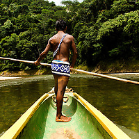 A young emberá in the Chagres River.  The Emberás are one of the seven indigenous groups still present in Panama.  They are usually find by the Chagres River in the Panama Canal protected areas as well as in the mountains and rivers of the Darien jungle