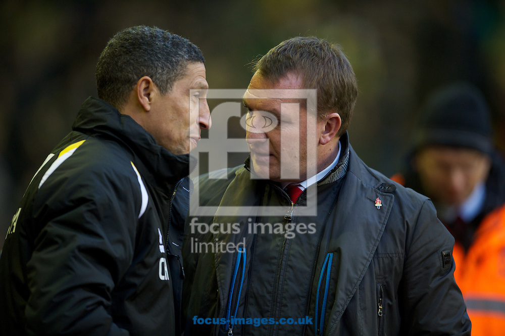 Picture by Dave Rawcliffe/Focus Images Ltd +44 7904 640267.19/01/2013.Liverpool's manager Brendan Rodgers and Norwich City's manager Chris Hughton before the Barclays Premier League match at Anfield, Liverpool.
