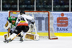 3.01.2014, Hala Tivoli, Ljubljana, SLO, EBEL, HDD Telemach Olimpija Ljubljana vs Dornbirner Eishockey Club, 63rd Game Day, in picture Luciano Aquino (Dornbirner Eishockey Club, #29) scores against Ales Sila (HDD Telemach Olimpija, #1) during the Erste Bank Icehockey League 63rd Game Day match between HDD Telemach Olimpija Ljubljana and Dornbirner Eishockey Club at the Hala Tivoli, Ljubljana, Slovenia on 2014/01/03. (Photo By Matic Klansek Velej / Sportida)