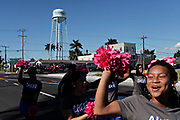 MELISSA LYTTLE   |   Times<br /> In a town with little else to cheer about, businesses close and schools empty out for the Pahokee Blue Devils' homecoming parade which snakes its way through the entire town, led by the varsity cheerleaders.