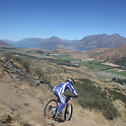Vironique Sandler from Nelson in action during the New Zealand South Island Downhill Cup Mountain Bike series held on The Remarkables face with a stunning backdrop of the Wakatipu Basin. 150 riders took part in the two day event. Queenstown, Otago, New Zealand. 9th January 2012. Photo Tim Clayton