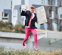 Roland Saunders as Donald Trump highlights his show outside the Scottish Parliament.<br /> <br /> © Dave Johnston/ EEm