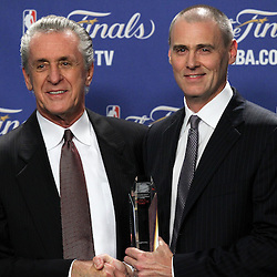 Jun 19, 2012; Miami, FL, USA; Dallas Mavericks head coach Rick Carlisle (right) presents hall of fame coach Pat Riley (left) with the Chuck Daly Lifetime Achievement Award at the American Airlines Arena. Mandatory Credit: Derick E. Hingle-US PRESSWIRE