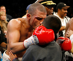 "November 10, 2007; New York, NY, USA;   A bloodied WBA Welterweight Champion Miguel Cotto kisses his son after his 12 round fight  against ""Sugar"" Shane Mosley at Madison Square Garden in New York, NY.   Cotto won the fight via unanimous decision."