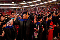 Grad students celebrate their degrees.