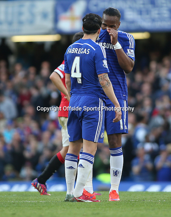 18 April 2015 - Barclays Premier League - Chelsea v Manchester United - Didier Drogba of Chelsea holds his shirt above his nose while talking to teammate Cesc Fabregas.<br /> <br /> <br /> Photo: Ryan Smyth/Offside