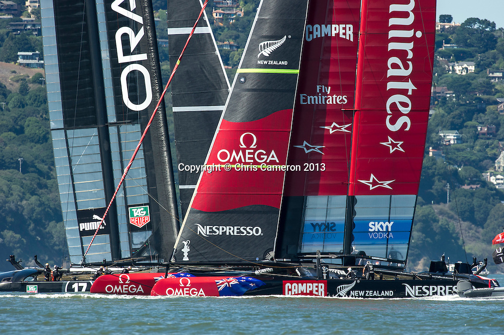 Emirates Team New Zealand and Oracle Team USA in pre start for race 16 on day 13 of America's Cup 34. 23/9/2013