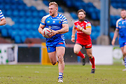 Halifax RLFC interchange Brandon Moore (14) on a breaking run during the Betfred Championship match between Halifax RLFC and London Broncos at the MBi Shay Stadium, Halifax, United Kingdom on 8 April 2018. Picture by Simon Davies.