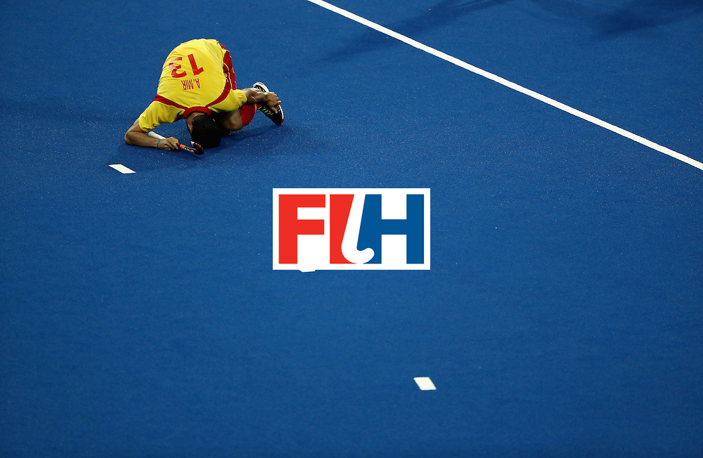 RIO DE JANEIRO, BRAZIL - AUGUST 12:  Andres Mir #13 of Spain lays injured against Great Britain during a Men's Preliminary Pool B match on Day 7 of the Rio 2016 Olympic Games at the Olympic Hockey Centre on August 12, 2016 in Rio de Janeiro, Brazil.  (Photo by Sean M. Haffey/Getty Images)