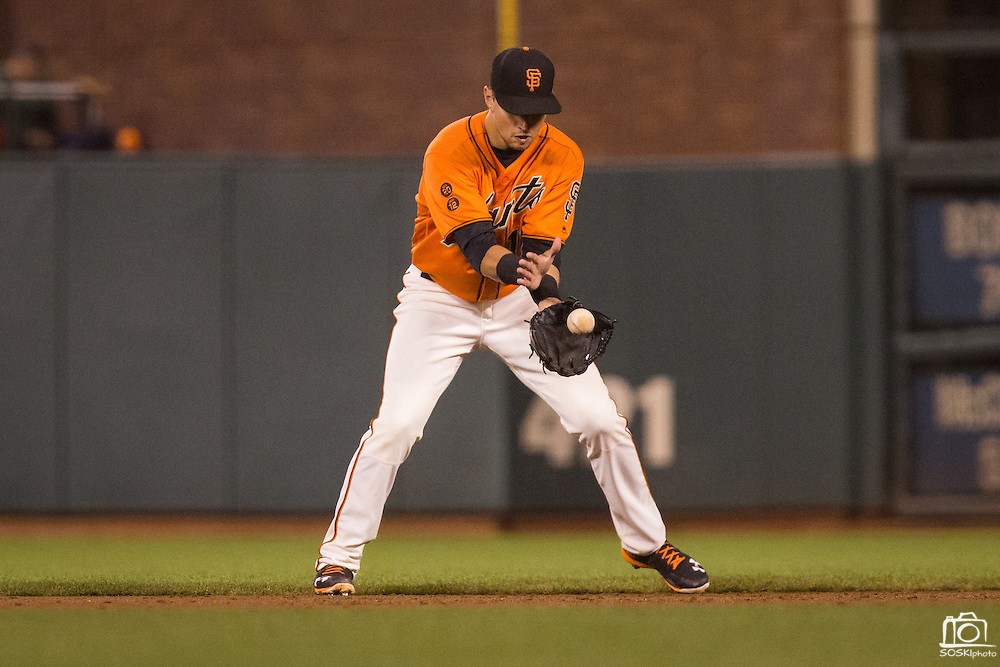 San Francisco Giants second baseman Joe Panik (12) fields a ground ball against the St. Louis Cardinals at AT&T Park in San Francisco, Calif., on September 16, 2016. (Stan Olszewski/Special to S.F. Examiner)