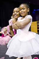 Two young ballerinas from the Tulsa Ballet Centre for Dance Education's Creative Movement class, backstage before performing.