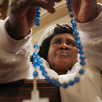 Marie Vital of Boston prays on a rosary during High Latin Mass at Holy Trinity Church in the South End, Sunday, April 15, 2007.  The archdiocese's only Latin Mass is being moved to a Newton parish.  Vital said she will not be able to attend the Newton church because she does not have transportation.