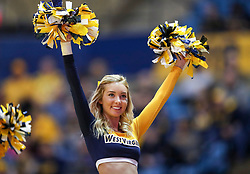 Dec 22, 2018; Morgantown, WV, USA; A West Virginia Mountaineers cheerleader performs during the first half against the Jacksonville State Gamecocks at WVU Coliseum. Mandatory Credit: Ben Queen-USA TODAY Sports