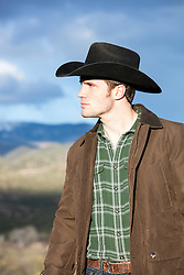 cowboy looking out on a mountain range
