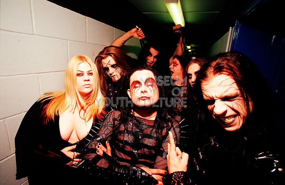 "Nu Metal ""Cradle Of Filth"" fans in corridor wearing black leather and make-up, UK, 2000s."