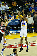 Golden State Warriors guard Patrick McCaw (0) shoots a three against the Portland Trail Blazers at Oracle Arena in Oakland, Calif., on October 21, 2016. (Stan Olszewski/Special to S.F. Examiner)