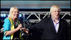 Boris Johnson with Anneka Rice on stage at the Celebration of the 2012 Olympic Games volunteering one year on at the  Queen Elizabeth Olympic Park.<br /> Mayor of London Boris Johnson and Lord Coe will be taking to the stage at Go Local to encourage a new drive in volunteering one year on from the Games. Also present are multi-platinum selling pop rock band McFly; world famous comedian Eddie Izzard, Brit Award nominated The Feeling, and Britain'Got Talent winners Attraction, in addition to stars Jack Carroll and Gabz. The event will be the UKs biggest ever celebration of volunteering and first Olympic and Paralympic legacy event at Queen Elizabeth Olympic Park.<br /> London, United Kingdom<br /> Friday, 19th July 2013<br /> Picture by Andrew Parsons / i-Images