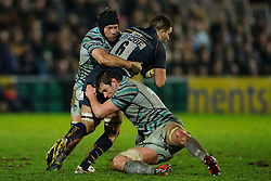 Worcester Flanker (#6) Sam Betty is tackled during the second half of the match - Photo mandatory by-line: Rogan Thomson/JMP - Tel: Mobile: 07966 386802 04/01/2012 - SPORT - RUGBY - Sixways - Worcester. Worcester Warriors v Leicester Tigers - Aviva Premiership.