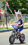 John Mills, 8 of Tullytown, Pennsylvania rides his patriotic decorated bicycle in the Tullytown Memorial Day Parade Saturday May 28, 2016 in Tullytown, Pennsylvania. Tullytown is celebrating it's  125th anniversary. (Photo by William Thomas Cain)