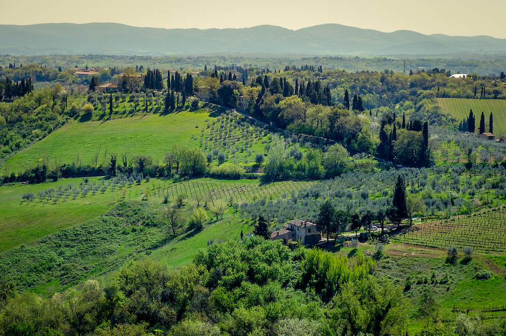 SAN GIMIGNANO, ITALY - CIRCA MAY 2015:  Landscape and vineyards over the hills near San Gimignano in Tuscany