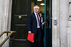 © Licensed to London News Pictures. 05/12/2017. London, UK. Secretary of State for Exiting the European Union David Davis leaving the Cabinet Office on Whitehall. Labour have been granted an urgent question in Parliament after Theresa May's meeting with EU leaders in Brussels on Monday 4 December 2017. Photo credit: Rob Pinney/LNP